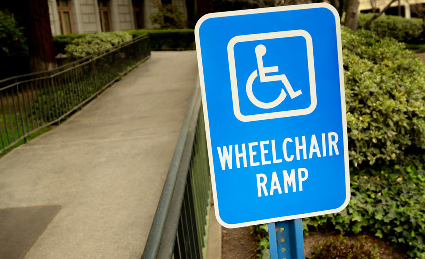 handicap parking lot ramp and sign
